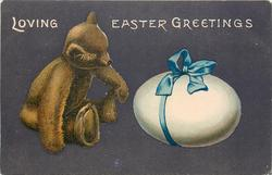 LOVING EASTER GREETINGS  teddy bear looks at egg tied with blue ribbon