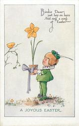 A JOYOUS EASTER  child in green outfit offers daffodil in pot to yellow bird