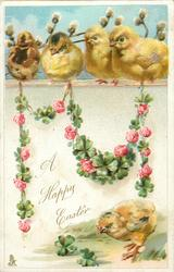 A HAPPY EASTER  garland of 4 leaf clover & pink roses hangs from wall with four chicks on it, one chick on ground below