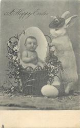 A HAPPY EASTER  baby in egg in basket, rabbit wearing hat, eggs