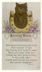 BIRTHDAY WISHES FOR THURSDAY  black cat sits in golden horseshoe, heather around