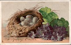 A HAPPY EASTER  nest of eggs, violets to right