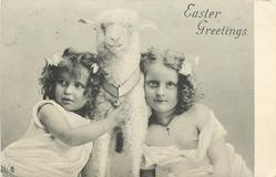 EASTER GREETINGS  head & shoulder study of girls on either side of toy lamb
