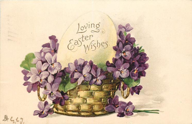 LOVING EASTER WISHES  written on fantasy egg in basket of violets