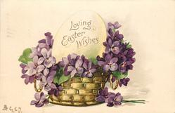 LOVING EASTER WISHES  written on fantasy egg in basket of violets