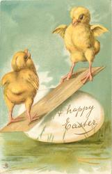 A HAPPY EASTER  on fantasy egg, two chicks see-saw on egg