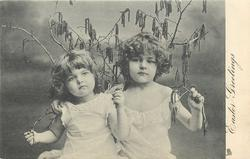 EASTER GREETINGS  two girls with branches & catkins, girl on left has her arm bent at elbow