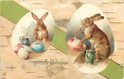 A HAPPY EASTER  two egg-shaped insets showing rabbits painting, green ribbon across card