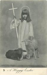 A HAPPY EASTER  girl standing between black and white lambs, cross in her hand