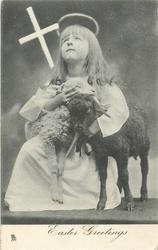 EASTER GREETINGS  girl kneeling down with sheep beside her and cross in her hand