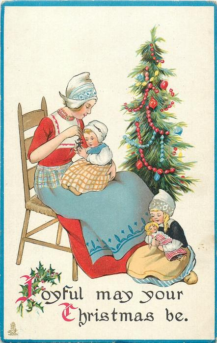 JOYFUL MAY YOUR CHRISTMAS BE  Dutch mother sits in chair with baby on lap, girl at her feet has doll, tree behind