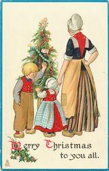 MERRY CHRISTMAS TO YOU ALL  Dutch boy shows girl the tree as she holds mother's hand