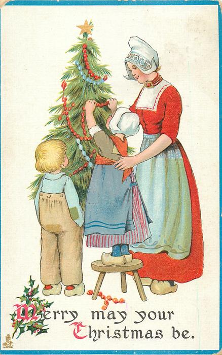 MERRY MAY YOUR CHRISTMAS BE  Dutch mother supports girl decorating tree, boy observes