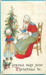 O JOYOUS MAY YOUR CHRISTMAS BE  Dutch mother sits in chair with baby on lap, girl admires tree