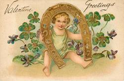 VALENTINE GREETINGS cupid in blue/green looks through large horseshoe