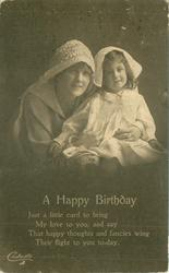 A HAPPY BIRTHDAY mother holds daughter, her left hand shows ring, child's hands both in view