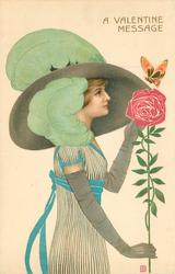 A VALENTINE MESSAGE  woman faces right with long stem rose,butterfly, large green feathers in hat