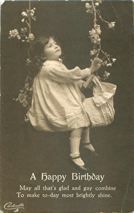 A HAPPY BIRTHDAY girl swings astride floral rope