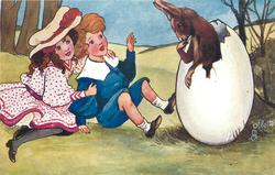 boy & girl watch rabbit hatching from egg
