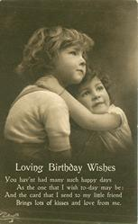 LOVING BIRTHDAY WISHES girl right with arms round the neck of boy left