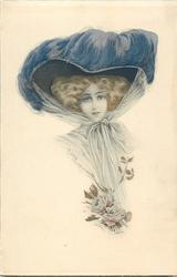 glamorous woman in large decorated hat, corsage of roses, faces & looks front, hat ribbons tied under chin