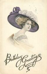 glamorous woman in large decorated hat, single rose corsage, faces right, looks front
