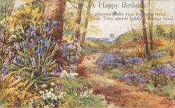 A HAPPY BIRTHDAY bluebells in rural setting, prominent path