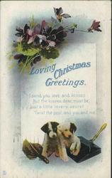 LOVING CHRISTMAS GREETINGS two puppies with brush & dustpan below & violets above