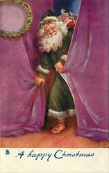 A HAPPY CHRISTMAS Santa in green robe comes from behind purple curtains
