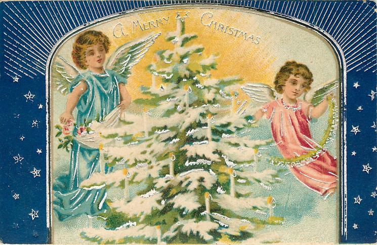 A MERRY CHRISTMAS  two angels one either side of snowy lighted Christmas tree