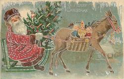 A MERRY CHRISTMAS  red robed santa drives sled right,  drawn by mule, carrying  Christmas tree