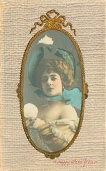 head & shoulder study, wears off-shoulder dress, blue trimmed hat & looks front