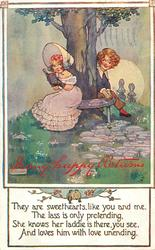 MANY HAPPY RETURNS  boy & girl sit on either side of a tree