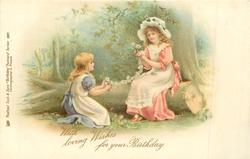 WITH LOVING WISHES FOR YOUR BIRTHDAY  two girls make daisy chain in woods, one sits on log, the other on ground in woods