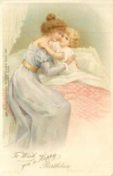 TO WISH YOU A HAPPY BIRTHDAY  mother in liilac dress hugs child in bed