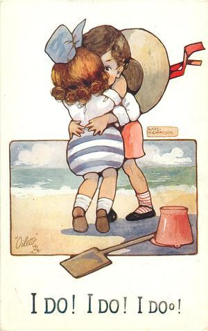 I DO! I DO! I DO!  two children embrace on the sand