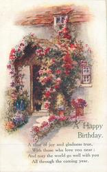 A HAPPY BIRTHDAY roses around cottage door, cat