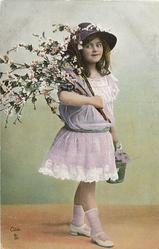girl in pale lilac dress, with spray of flowers over her right shoulder, holds pail in left hand