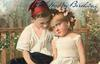boy and girl sitting in front of fence