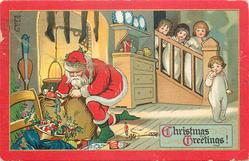 CHRISTMAS GREETINGS!  Santa with sack of toys, four children in white night attire come down stairs