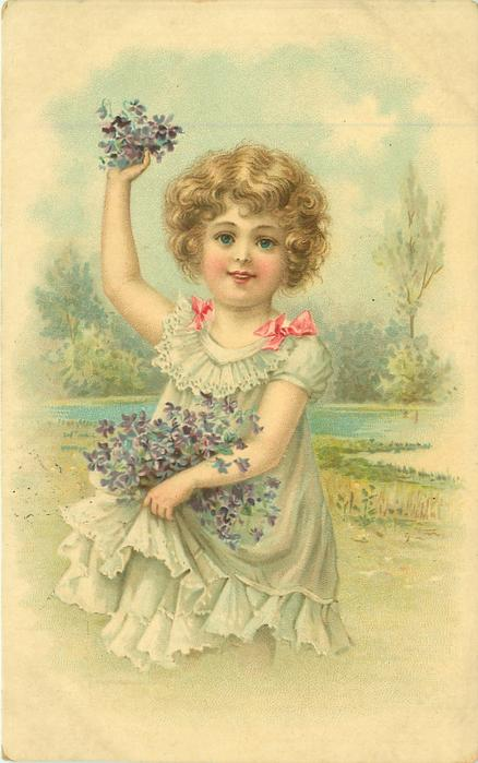girl in pale blue dress holds violets up in the air with her right hand & skirtful of violets with her left, rural background