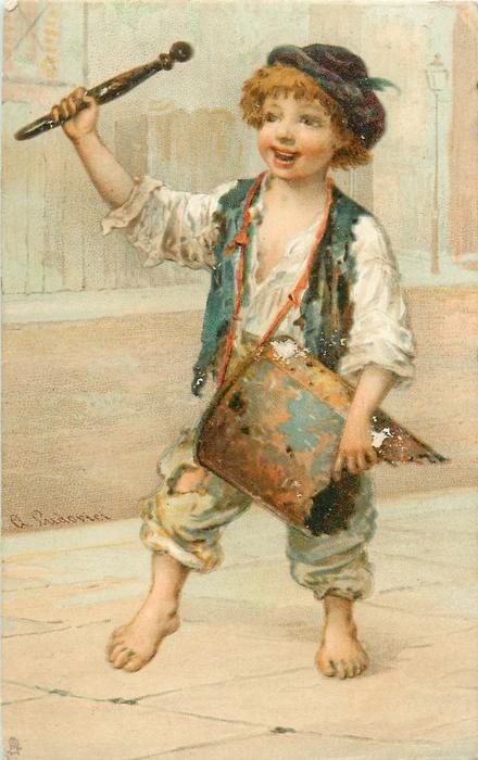 boy drumming on makeshift old tin drum