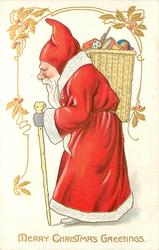 MERRY CHRISTMAS GREETINGS Santa in red coat with white trim, carries stick, wicker basket on shoulder walking & looking left
