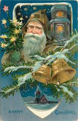 A HAPPY CHRISTMAS  brown suited santa, tree in his left hand, two bells right, round insert below
