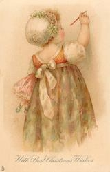 WITH BEST CHRISTMAS WISHES  girl standing facing away, doll under arm, writing on wall