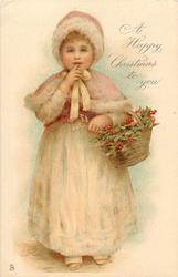 A HAPPY CHRISTMAS TO YOU  girl with basket of holly, finger to mouth, stands facing front