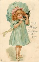 A HAPPY CHRISTMAS TO YOU  girl in blue holding a kitten feeding it milk