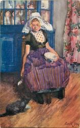 THE BLACK CAT  Dutch girl sits holding bowl on lap, spoon in her right hand, cat on floor