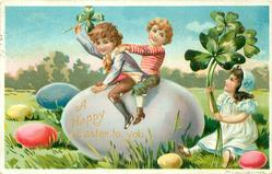 two boys sit on gigantic purple Easter egg, girl sits right with exaggerated 4 leaf clover, other eggs on grass