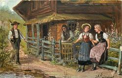 DIE DORFSCHONEN  two girls lean talking against fence, man walks front on left, woman back against house